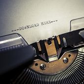 stock photo of short-story  - Typewriter closeup short concept of download text - JPG
