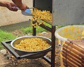 Making Popcorn A Caramel Coated Treat In Market