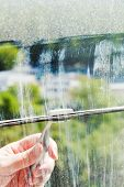 Cleaning Of Home Window Glass By Squeegee