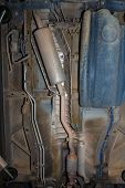 pic of exhaust pipes  - Car underbody exhaust pipe fuel tank of used vehicle - JPG