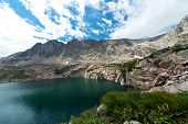 Colorado Mountain Lake And Waterfall