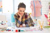Portrait Of Concerned Seamstress In Studio