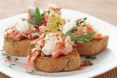Crab meat with toast, sauce and herbs in plate