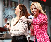 NEW YORK-MAY 23: Country music singer Sara Evans (L) and Elisabeth Hasselbeck on stage at Fox and Fr