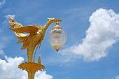 picture of stature  - architecture stature golden of bird and white cloud in village Thailand.