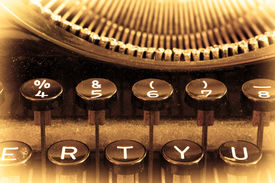 picture of qwerty  - Close up of a dirty vintage typewriter warm filter - JPG