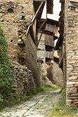 picture of old stone fence  - Old building made of stone roof tiles in Bulgaria - JPG