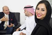 foto of hijabs  - Arabian Businesswoman in office with Businesspeople meeting in the background - JPG