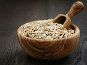 Oat Flakes In Wood Bowl On Oak Table