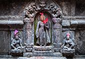stock photo of pooja  - Hindu statues with deities in the temple of Patan Nepal - JPG