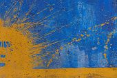 Yellow Spray On Blue Painted Wall