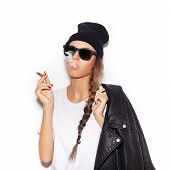 image of tobacco smoke  - Hipster girl in sunglasses with black leather jacket smoke tobacco - JPG