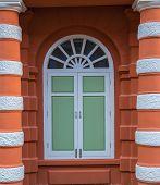Green vintage widows on brick build