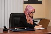 Muslim Businesswoman Working With Documents In The Office