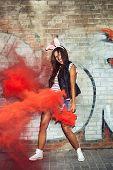 Sexy Woman In Rabbit Ears Waving Red Smoke Bombs
