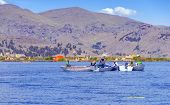 PUNO, PERU, MAY 5, 2014: Uros islands on Titicaca lake - fishermen catch fish from their boats