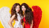 Glamorous Fashion Beautiful Angel Girls With Angel's Wings. Valentine Day Women.  Isolated On Yellow