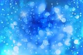Blue background with real bokeh effect and snowflakes and snow