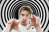 stock photo of dizziness  - Image of a hypnotist brainwashing the viewer into a deep subconscious subliminal trance using secret mind control tactics - JPG