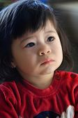 two years old asian child portrait. Father european, mother chinese.