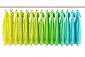 Assorted shirts hanging in a fashion store on a clothes rack (3D Rendering)