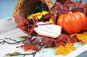 Happy Thanksgiving Cornucopia With Autumn Fall Leaves, Pumpkin, Sunflower And Berries On White Shabb