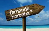 Fernando de Noronha, Brazil wooden sign with a beach on background