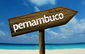 Pernambuco, Brazil wooden sign with a beach on background