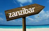 Zanzibar wooden sign with a beach on background