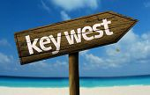 Key West - Florida, United States wooden sign with a beach on background