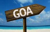 Goa, India wooden sign with a beach on background