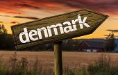 Denmark wooden sign in a rural background