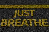 Just Breathe text on the asphalt