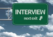 Interview, next exit creative road sign and clouds