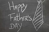 Happy Fathers Day written on the blackboard