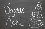 Christmas tree on blackboard and the text Joyeux Noel ( Merry Christmas in French )