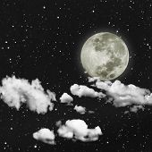 Amazing Night sky with stars, full moon and strong white clouds