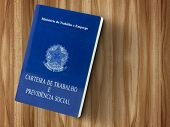 Brazilian document work and social security ( Carteira de Trabalho e Previdencia Social) on wood table