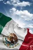 Amazing Flag of Mexico with a beautiful blue sky as the background - Central America