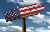 USA flag wooden sign with a beautiful sky on background - North America