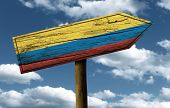 Colombia flag wooden sign with a beautiful sky on background - Latin America