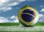 foto of netball  - Soccer ball with Brazilian flag in a green field - JPG