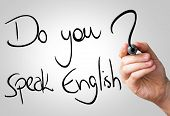 Do you speak English hand writing with a black mark on a transparent board