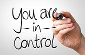 You are in Control hand writing with a black mark on a transparent board
