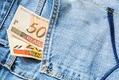 picture of brazilian money  - 50 Reais on the jeans  - JPG