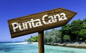 Punta Cana, Dominic Republic wooden sign with the beach on background