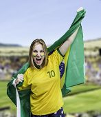 Woman holds a flag of brazil on the Stadium