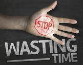 Educational and Creative composition with the message Stop Wasting Time on the blackboard