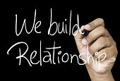 We build relationship hand writing on white marker on transparent wipe board