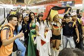 SAO PAULO, BRAZIL - JUNE 12, 2014: Beautiful girls go to Arena Sao Paulo for the first game of the the Brazilian World Cup 2014 (Brazil x Croatia).